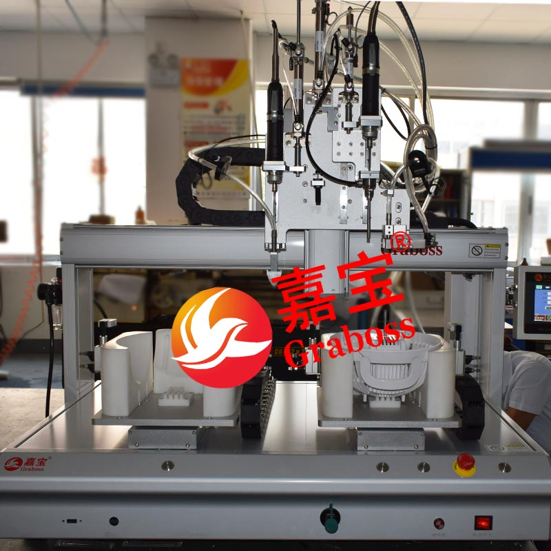 重庆某企业桌面四轴双起子锁电风扇螺丝机案例