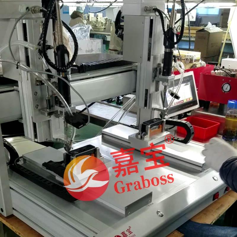 昆山某有限公司桌面型双三轴锁小音响自动螺丝机案例